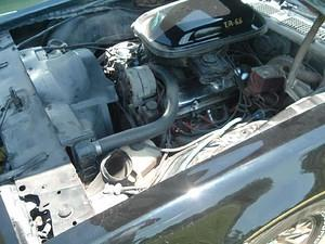 What my engine compartment looked like upon delivery.  Dirty after 26 years, but the W72 400 was all there and ready to run.