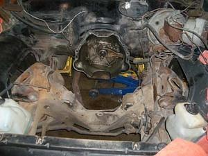 What the engine compartment looked like before...
