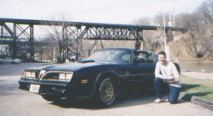 Here is a recent picture of me and my car taken for its first run in 2004 after a long cold winter
