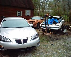 "Here is my Pontiac ""Collection"". My wife's 2004 Grand Prix, the Y-84 and the 87 with the hoist holding the 455 oil pan off the frame."