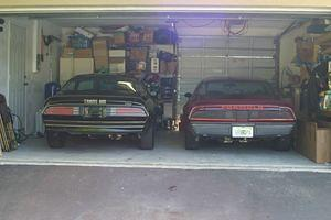 77 Trans Am pre-restoration next to my first car, a 1979 Formula that I have had since 1984.
